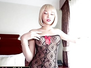 Dazzling Asian shemale in sexy lingerie sucks dick and rides